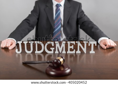 Judgment concept with a lawyer in background - stock photo