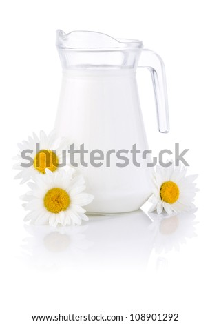 Jug fresh milk and three chamomile flowers isolated on white background - stock photo