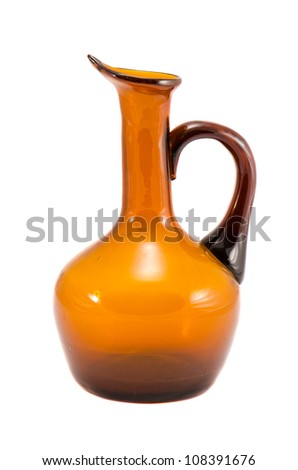 Jug vase made of yellow brown glass isolated on white background. - stock photo