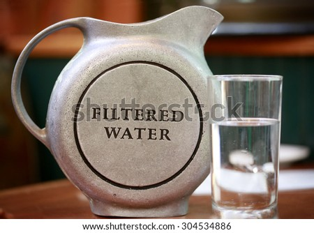 Jug with filtered water - stock photo
