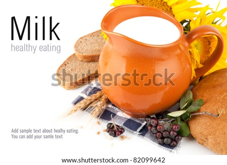 jug with milk and bread isolated on white background - stock photo