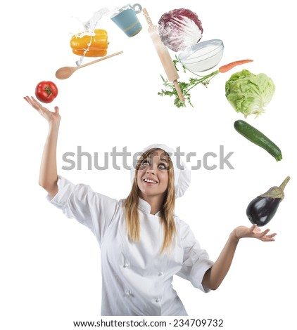 Juggler chef play with some ingredients and kitchen tools - stock photo