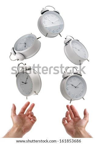 Juggling time and a busy life schedule - stock photo