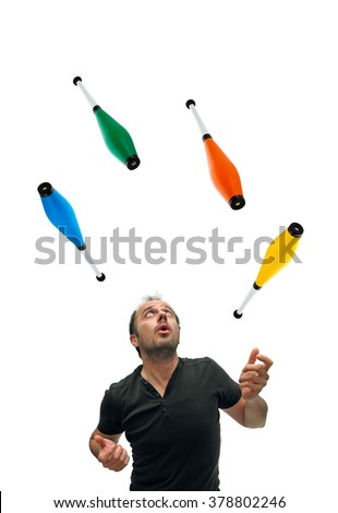 Juggling with colorful pins - stock photo