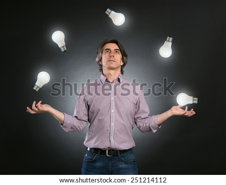 Juggling with new ideas - stock photo