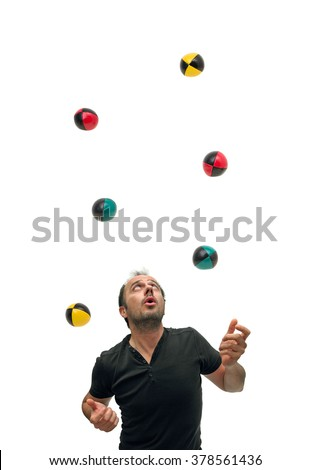 Juggling with six balls - stock photo