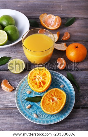 Juice and citrus on table close-up - stock photo