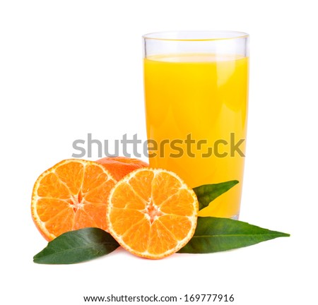 Juice from yellow tangerines in glass on white background