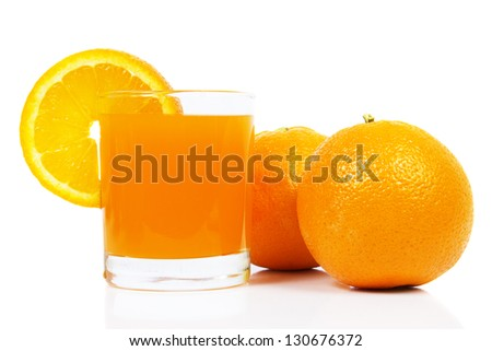 Juice glass and orange fruit isolated on white background cutout - stock photo