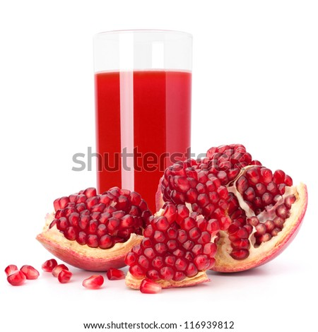 Juice glass and pomegranate fruit isolated on white background cutout - stock photo