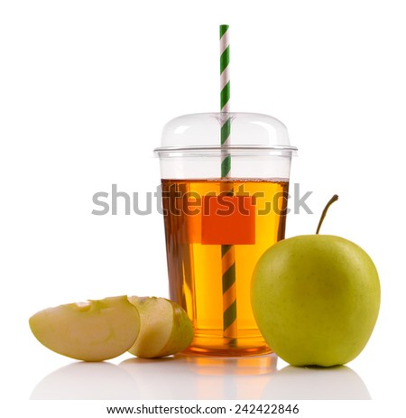 Juice in fast food closed cup with tube and apples isolated on white - stock photo