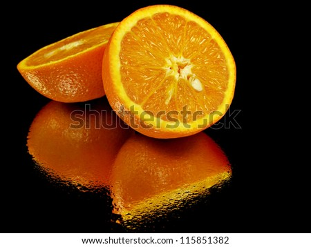 juice orange fruit on a black background with water drops - stock photo