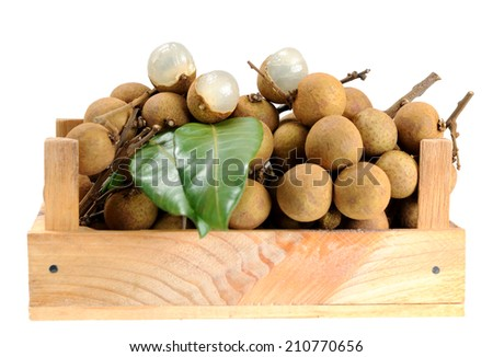 juicy and delicious longan in wooden crate isolated on white background  - stock photo