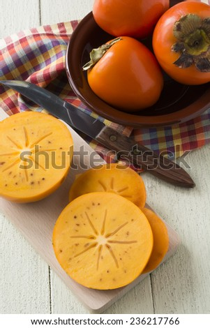 Juicy and ripe persimmon.Background.Selective focus. - stock photo