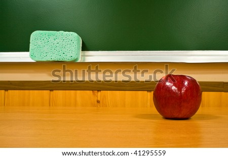 juicy apple at school on a background a board - stock photo