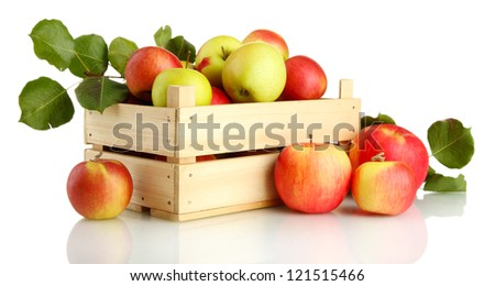 juicy apples with green leaves in wooden crate, isolated on white - stock photo