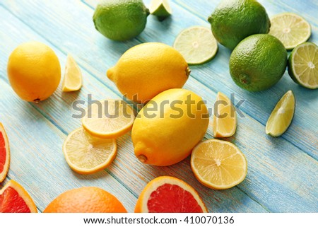 Juicy composition of citrus fruits on wooden background, close up - stock photo