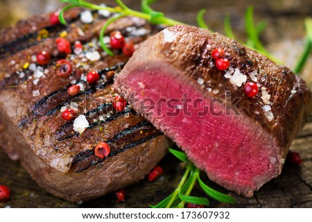 Juicy Fillet Steak with Fresh Herbs   - stock photo