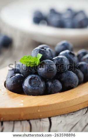 Juicy fresh blueberries on old wooden background, selective focus