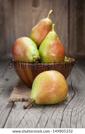 Juicy fresh pears on a dark wooden background - stock photo
