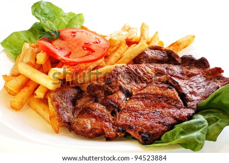 juicy grilled pork chop (neck cut) with potato - stock photo