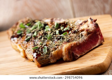 Juicy Grilled Steak on a Cutting Board. - stock photo