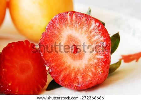 Juicy half slice of strawberry  - stock photo