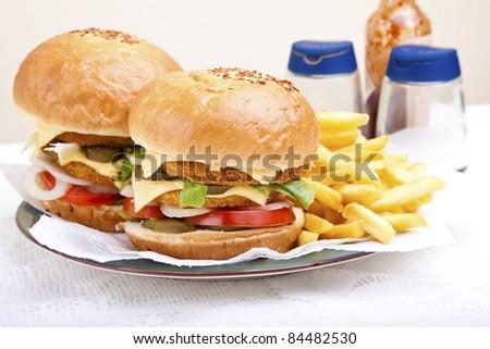 Juicy huge chicken scallop burger - stock photo