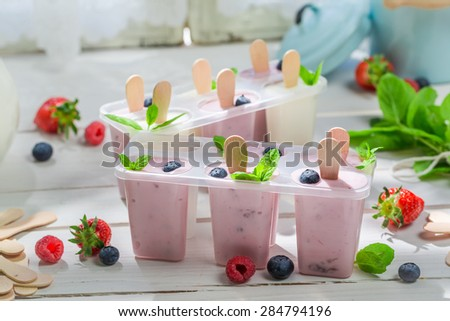 Juicy ice cream with fresh berry fruits - stock photo