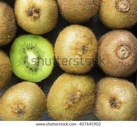 Juicy kiwi fruit on wooden background, room for text. selective focus - stock photo