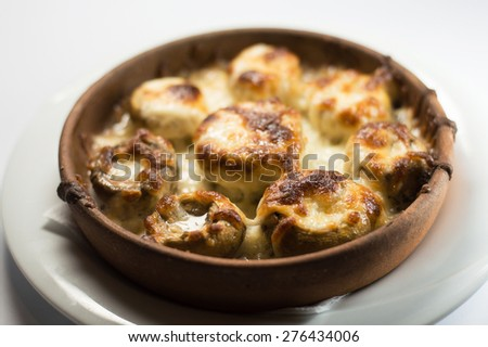 Juicy Mushrooms baked with cheese - stock photo