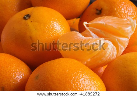 juicy orange mandarins are as a background