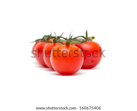 Juicy organic Cherry tomatoes isolated on white background