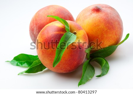 Juicy Peaches with leaves Isolated on White Background - stock photo