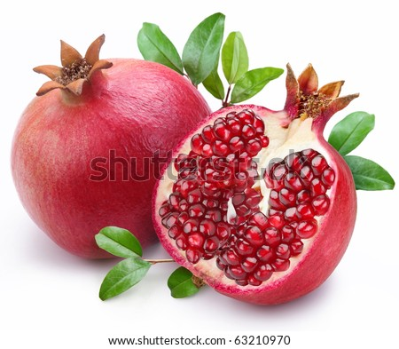 Juicy pomegranate and its half with leaves. Isolated on a white background. - stock photo