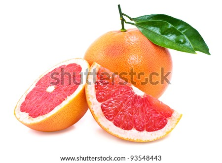 Juicy ripe grapefruit with green leaves. - stock photo
