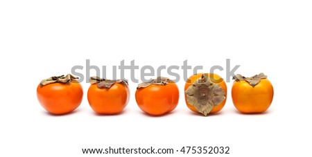juicy ripe persimmon isolated on white background close-up. horizontal photo.