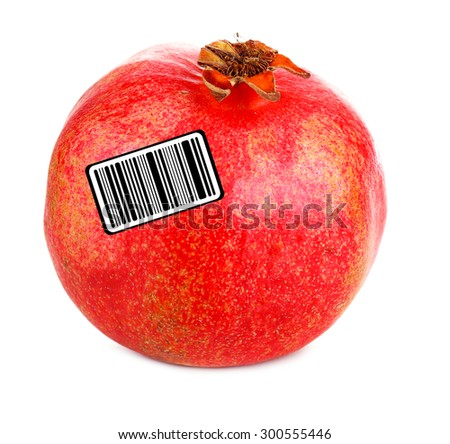 Juicy ripe pomegranate with barcode, isolated on white - stock photo
