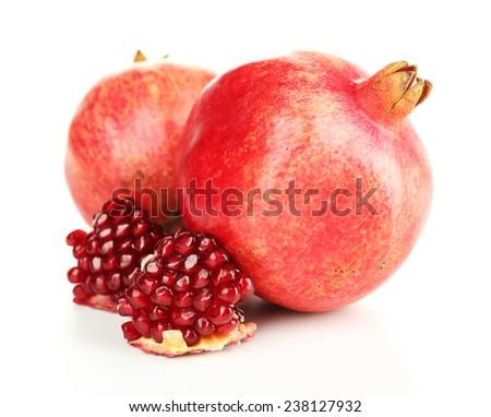 Juicy ripe pomegranates, isolated on white - stock photo