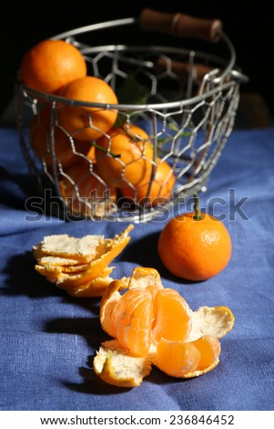 Juicy ripe tangerines on tablecloth - stock photo