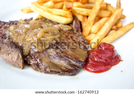 juicy steak beef meat and french fries