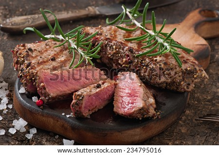 Juicy steak medium rare beef with spices - stock photo