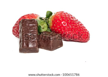 juicy strawberries and chocolate pralines on a white background - stock photo