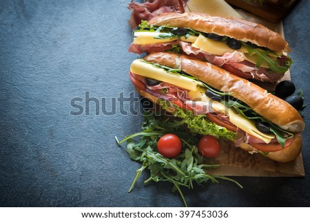Juicy submarine sandwich and coke on the table,selective focus and copy space  - stock photo