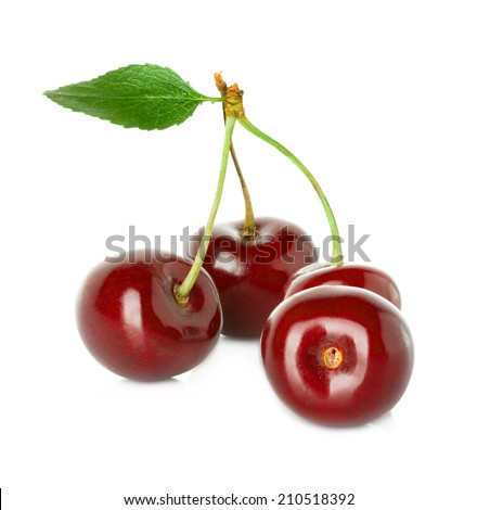 Juicy sweet cherry with leaf isolated on white background