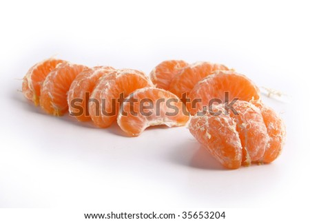 Juicy tangerine slices. Fresh fruit isolated on white background