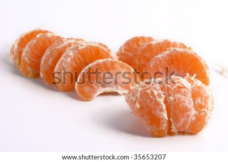 Juicy tangerine slices on white background