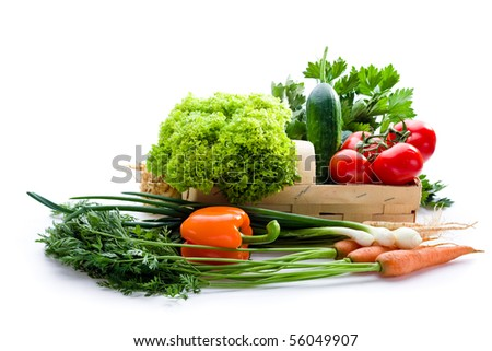 Juicy vegetables in punnet on white background - stock photo