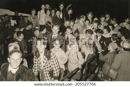 JUIST, GERMANY, CIRCA FIFTIES - Vintage photo of group of children during a school trip - stock photo