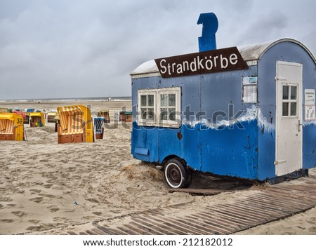 Juist, Germany - July 13: At the beach. In the foreground one bauwagen, in which you rent the beach chairs. Juist, Germany - July 13, 2012.